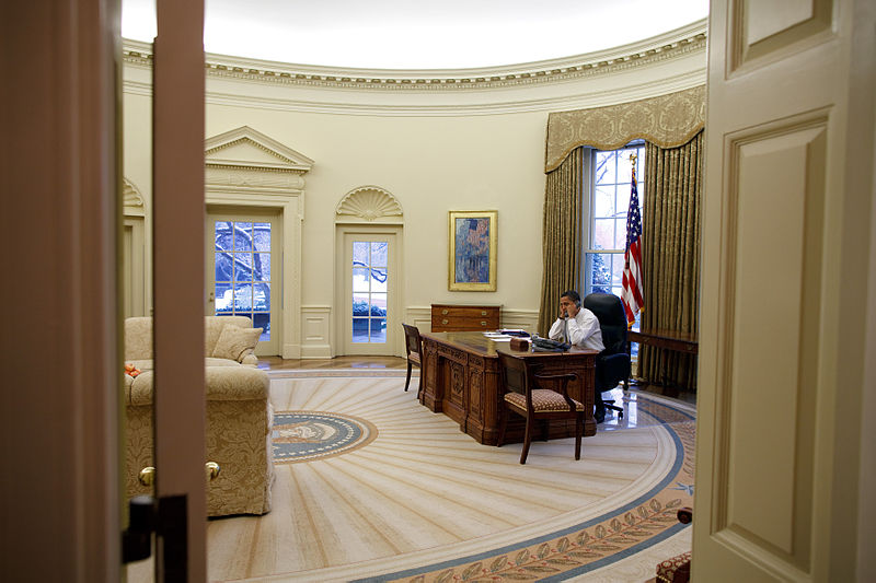 Barack_Obama_in_the_Oval_Office_view_from_the_west_corridor (1)