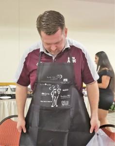 Josh admiring his apron